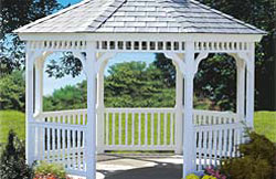 "12' Octagon No1 white vinyl gazebo with 2"" x 3"" turned spindles, gray rubber slate roof and gray composite flooring."