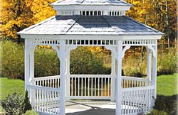 "12' Octagon Pagoda No10 white vinyl gazebo with 2"" x 2"" turned spindles, gray rubber roof and gray composite flooring."