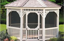 "12' Octagon Victorian No5 white vinyl gazebo with 2"" x 2"" balusters, chestnut brown rubber slate roof, brown composite flooring."